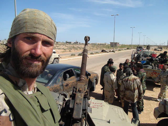 Freedom fighter Matthew VanDyke with his military unit during the Libyan Civil War