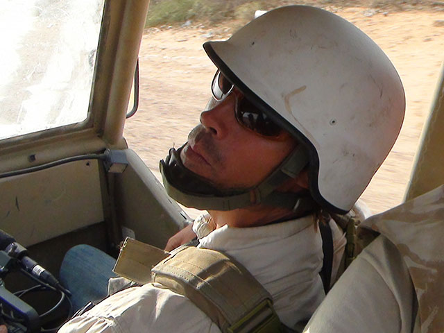 Journalist James Foley riding in Matthew VanDyke's KADDB Desert Iris 4x4 vehicle in Libya during the Libyan Revolution