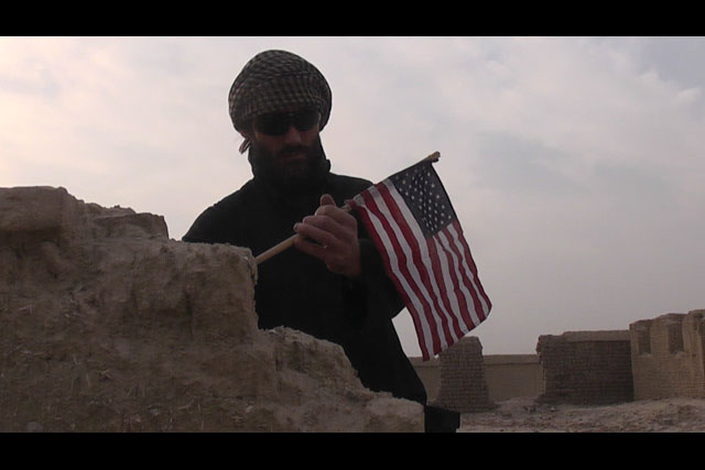 journalist matthew vandyke putting a flag in osama bin laden house in jalalabad afghanistan