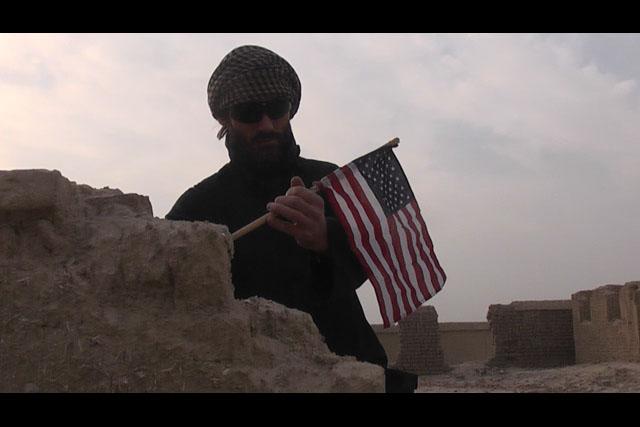 journalist matthew vandyke putting a flag in osama bin laden house in jalalabad afghanistan