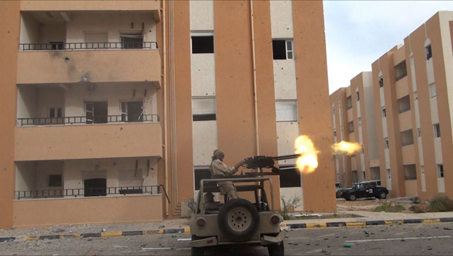 freedom fighter matthew vandyke firing his dshk machine gun in his kadbb military jeep in sirte libya during the libyan civil war