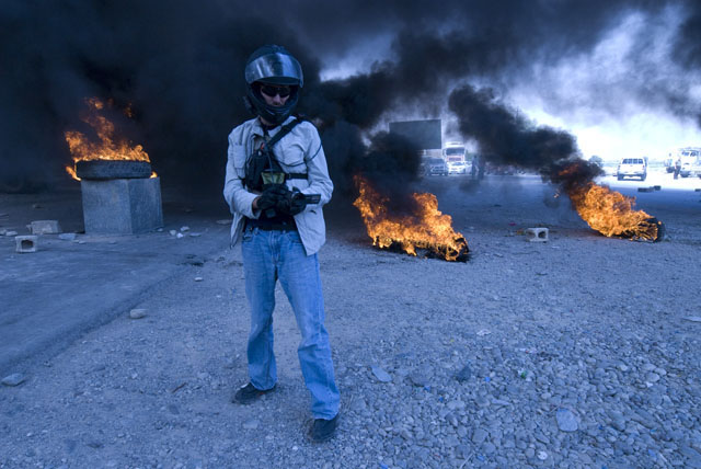 Matthew VanDyke filming a protest in Iraq
