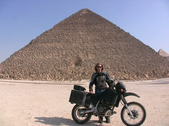 matthew vandyke with his kawasaki klr650 motorcycle in front of a pyramid in giza egypt