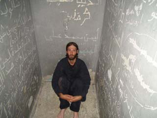 Matthew VanDyke the American prisoner of war sits in his cell at Maktab al-Nasser prison in Tripoli Libya