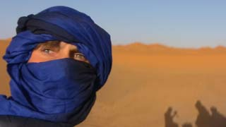 Matthew VanDyke wearing a Tuareg tagelmust in the Sahara desert