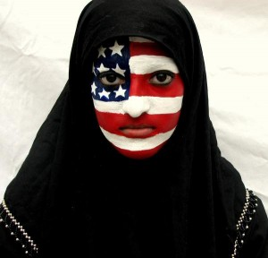 Muslim woman with American flag face paint