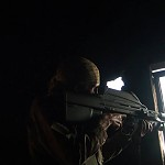 Matthew VanDyke shooting at a sniper in Libya in a scene from the film Point and Shoot